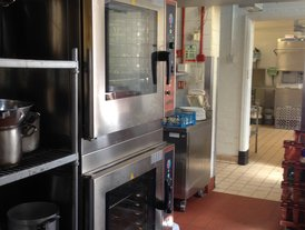 Commercial kitchen extraction canopy with fresh air input and  twin stacked Lainox combination ovens