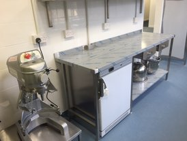 Stainless steel food preparation table with sink unit and fridge