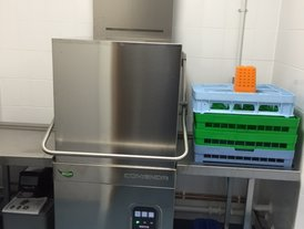 Dish washer with heat recovery system and automatic water softener